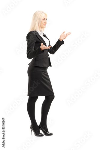 Full length portrait of a businesswoman gesturing with hands