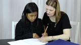 Mother Helps Asian Daughter With Homework