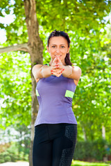 Woman exercising yoga in park