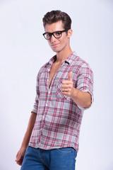 casual man shows thumb up