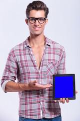 casual man presents his tablet