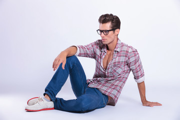casual man posing on the ground