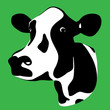 a cow head silhouette on a green background