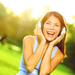 Woman listening to music in headphones singing