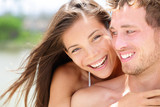 Happy romantic couple on beach in love