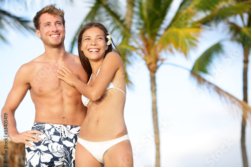 Romantic couple on happy beach travel