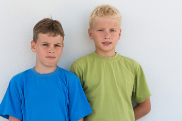 Portrait of two boys in colored T-shirts.