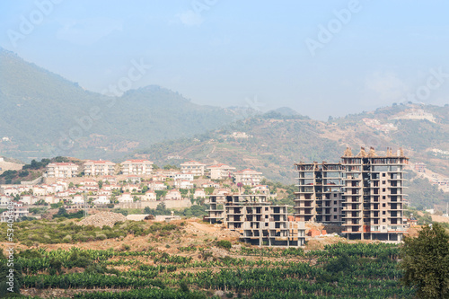 Under construction building in landscape with mountains