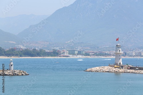 Beautiful landscape with sea, lighthouse, mountain and coastline