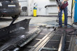 Repairman washes car parts before repairs on body shop