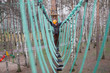 Little climber takes the rope bridge