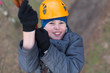 Smiling little climber passes obstacle