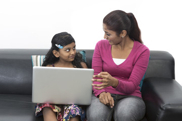Indian Mother And Daughter Using Laptop together