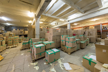 Large warehouse with cardboard boxes