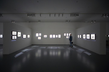 Man on photo exhibition