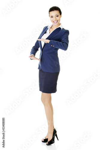 Happy young business woman showing rounding copy space