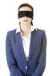 Portrait of a beautiful young blindfold businesswoman