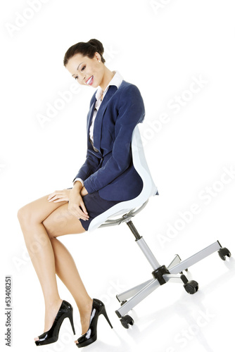 Beautiful successful businesswoman sitting on ofice chair