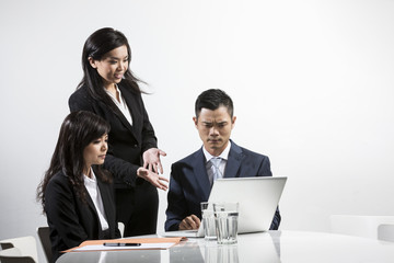 Angry Asian business people having a meeting together
