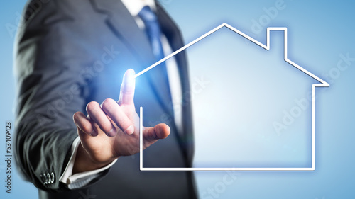 canvas print picture Geschäftsmann mit Haus-Symbol