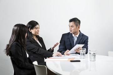 Chinese business people having a meeting