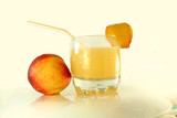 peach and peach juice in white background