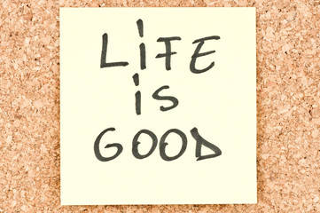 Life is Good, handwritten on a sticky note