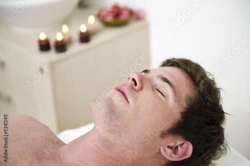 Young man relaxing in health spa