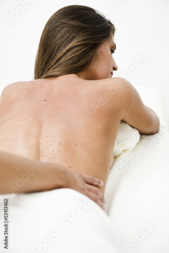 Young woman getting back massage