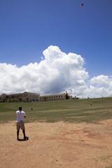 Man flying kite in San Juan park
