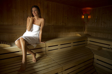 Young woman relaxing in sauna