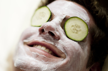 Young man getting a facial treatment