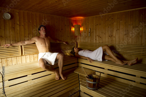 Young couple relaxing in sauna
