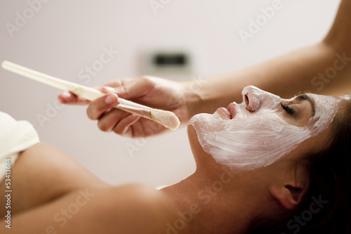 Young woman getting a facial treatment
