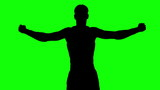 Silhouette of a man stretching arms on green screen