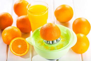 orange squeezer with fresh fruits