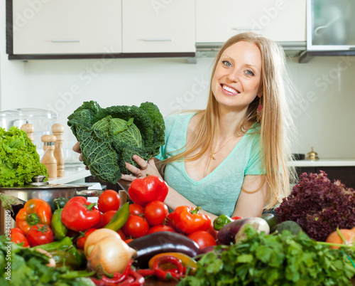 Portrait of  housewife with  cabbage and  vegetables