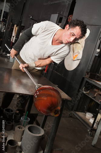 Man Checking His Glass Vase