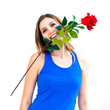 woman holding red rose in her mouth