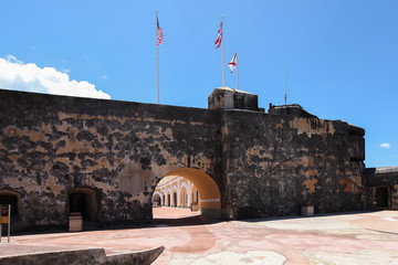Flags fly above Fortification walls in El Morro