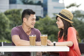 Romantic Chinese Couple Enjoying a Coffee together.