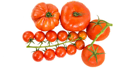 A group of various type and sizes of tomatoes