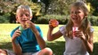 Siblings having fun together with bubbles