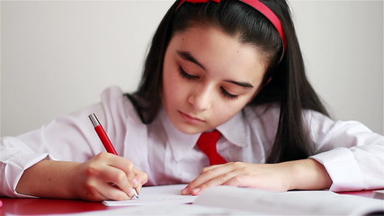 School girl doing her homework