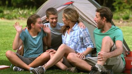 Little boy joking at campsite