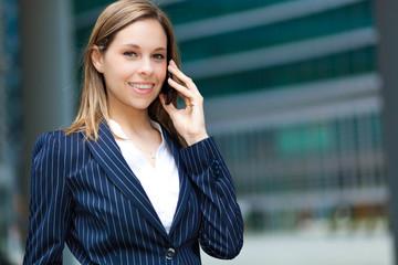 Beautiful businesswoman at phone