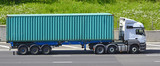 Shipping container articulated trailer and lorry on motorway