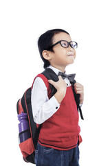 Asian nerd boy bring bag - isolated