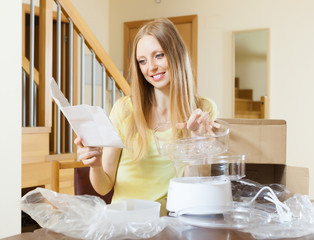 cheerful woman reading user manual for  steamer