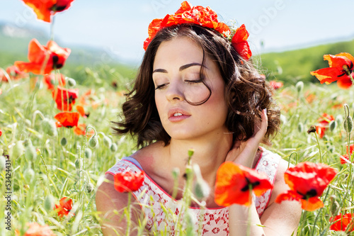 Young girl  in poppies field